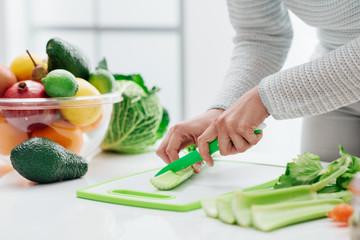 Woman chopping celery