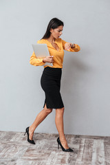 Vertical image of Business woman holding tablet computer