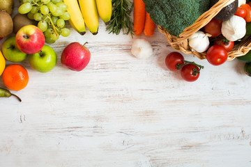 Variety of fruits and vegetables, on the white wooden table, top view, copy space, selecitve focus