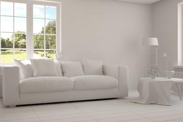Grey room with sofa and green landscape in window. Scandinavian interior design