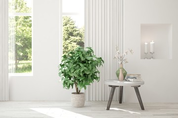 White empty room with flower and green landscape in window. Scandinavian interior design