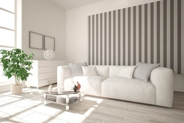 White room with modern sofa. Scandinavian interior design