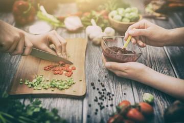 Fototapeta Preparing a meal. Cutting vegetables. obraz