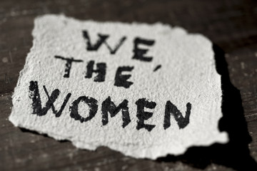 text we the women in a piece of paper
