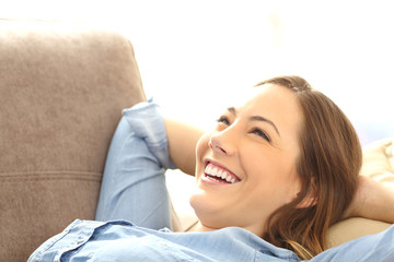 Woman relaxed lying on a couch