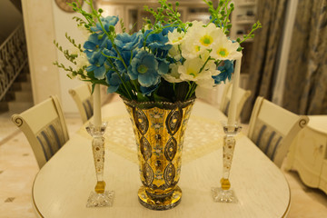 Flowers in gold vase