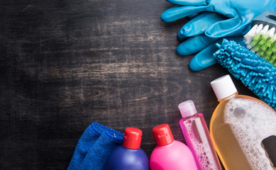 Cleaning products and tools on a wooden floor,Cleaning concept