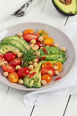 Detox avocado salad with chick pea and tomatoes.Super foods and clean eating concept.Selective focus