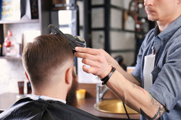 Barber making modern male hairstyle