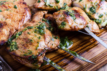 Grilled chicken skewers with chimichurri sauce