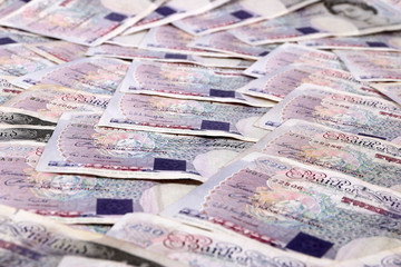 paper notes British pounds on the table as a symbol of success and abundance