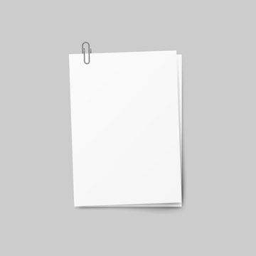 Realistic several sheets of paper and a metal paper clip isolated on background. 3d Vector illustration