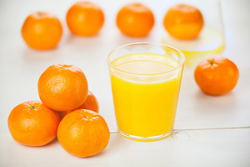 Delicious fresh squeezed tangerine juice in  transparent glass