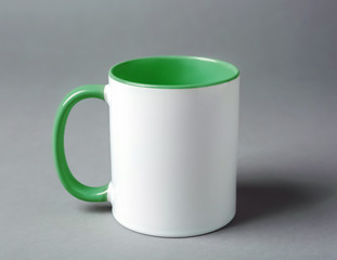 Blank ceramic cup on grey background