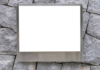 blank of aluminum photo frame or empty poster billboard on stone brick wall for concept design