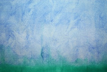 Watercolor blue surface like sky or landscape view with green grass below