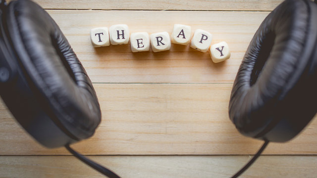 Relaxation and cozy with word therapy on wooden background and copy space for music, therapy  concept