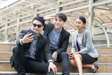 Asia business people or businessman and businesswoman selfie outdoor, Protrait business concept.