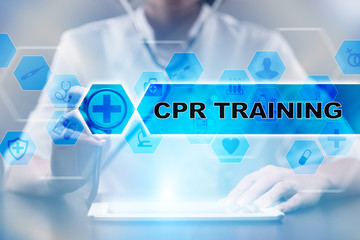 Medical doctor using tablet PC with cpr training medical concept.
