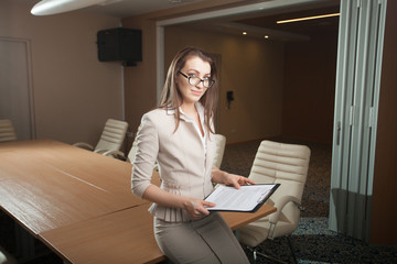 portrait of business woman holding tablet in office