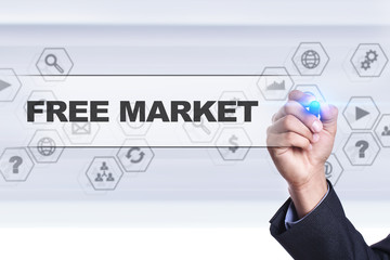 Businessman drawing on virtual screen. free market concept.