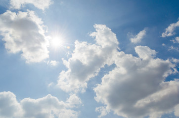 Sunshine on blue sky with white cloud
