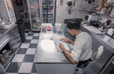 chef ordering writing papers kitchen