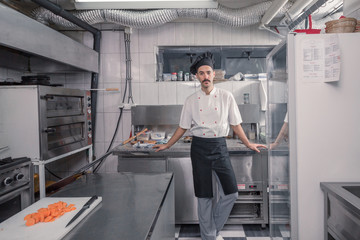 chef posing, looking at camera, commercial kitchen