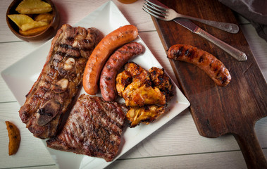 Mixed barbecue grill meats and sausages.