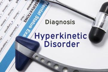 Diagnosis of Hyperkinetic disorder. Two neurological hammer, result of mental status exam and name of neurologic psychiatric diagnosis Hyperkinetic disorder on a white background or on doctor table