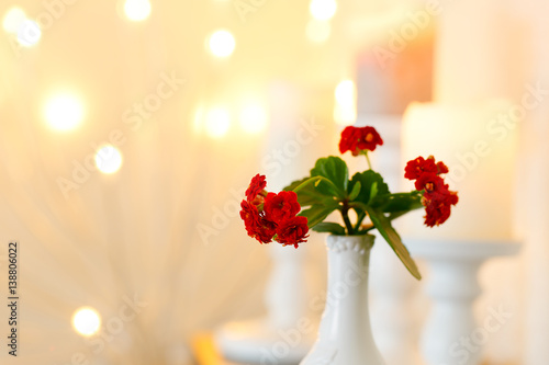 Flowers In A Vase Against A Backdrop Of Candles And Lights Postcard