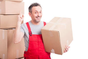 Mover guy holding cardboard box making great idea gesture