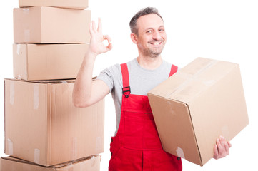Portrait of mover guy holding box showing okay gesture