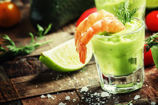 Shrimp and avocado, old wooden background, selective focus