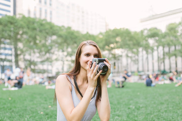 American Girl with Vintage Camera in Bryant Park, Manhattan