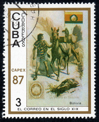 UKRAINE - CIRCA 2017: A stamp printed in Cuba, shows a man leading a horse Bolivia, the series The mail in the nineteenth century, circa 1987
