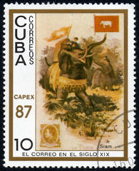 UKRAINE - CIRCA 2017: A stamp printed in Cuba, shows a man with a load moves on an elephant Siam, the series The mail in the nineteenth century, circa 1987