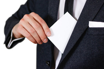 Businessman putting paper in suit pocket closeup. Showing blank flyer brochure booklet. Pamphlet hold hands. Show clear offset paper. Sheet template. Man in a black suit, white shirt and tie.