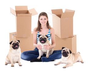 young woman with brown cardboard boxes and cute pug dogs isolated on white