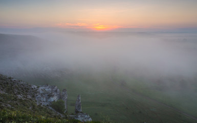 landscape of dense fog in the field at sunrise