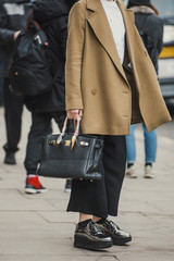 Stylish outfit outside the London Fashion Week show.