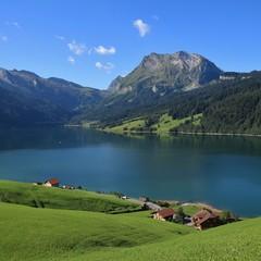 Green meadow, blue lake Wagital and mount Fluebrig