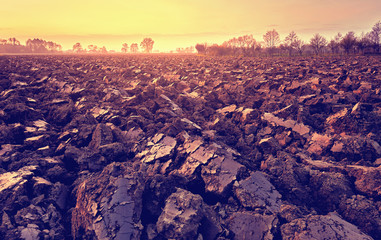 plowed soil. spring field. sunset over ploughed field. Countryside lanscape