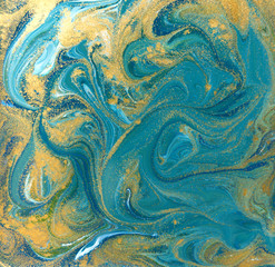 Blue, green and gold liquid texture. Hand drawn marbling background. Ink marble abstract pattern