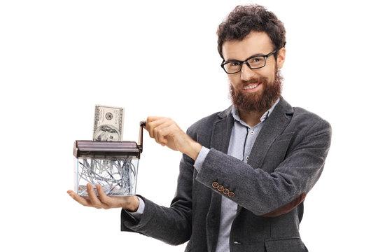 Man destroying a dollar banknote in a paper shredder