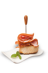 Smoked meat slices - mini ham sandwich on white background