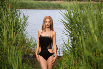 Sexy girl in black bathing suit