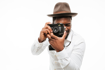 Happy young african photographer dressed in shirt