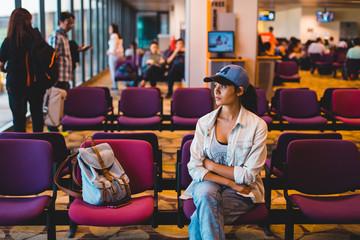 Young woman waiting at airport lounge
