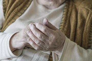 Close up wrinkled hands